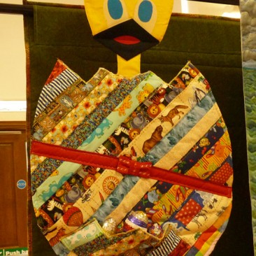 12:-Cheepy, Cheepy Chick By Grace Cole (Age 8) / Pattern from Patchwork and Quilting magazine (Ruby McAlister). Pocket added by myself.