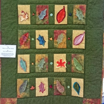 13:-Twenty Floating Leaves By Holly Bond (Age 14) / Instructions and inspiration from Valerie Van-Arsdale's book 'Simple Contemporary Quilts'. Leaves designed by myself.