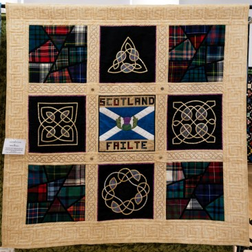 24:-Meeting of the Clans By Moira Bagnall / The panels were made then joined as 'quilt as you go'. A triple needle was used for the bands and finished with Key pattern. 'Failte' means welcome in Gaelic.