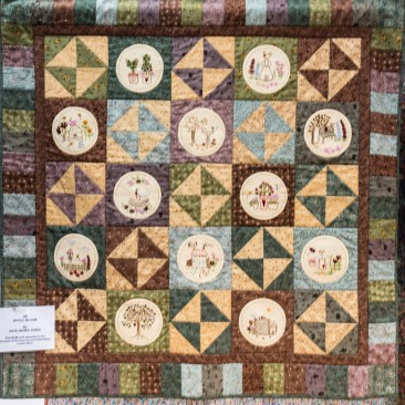 39:-In Full Bloom By Kate Bankes-Jones /  This BOM quilt appealed to me because of the piecing and embroidery combination.