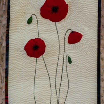 40:-Poppies By Kate Bankes-Jones / I was keen to try this type of hand-quilting in a small design.