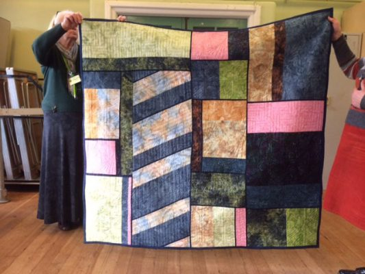 Claire Powell with her beautiful abstract quilt